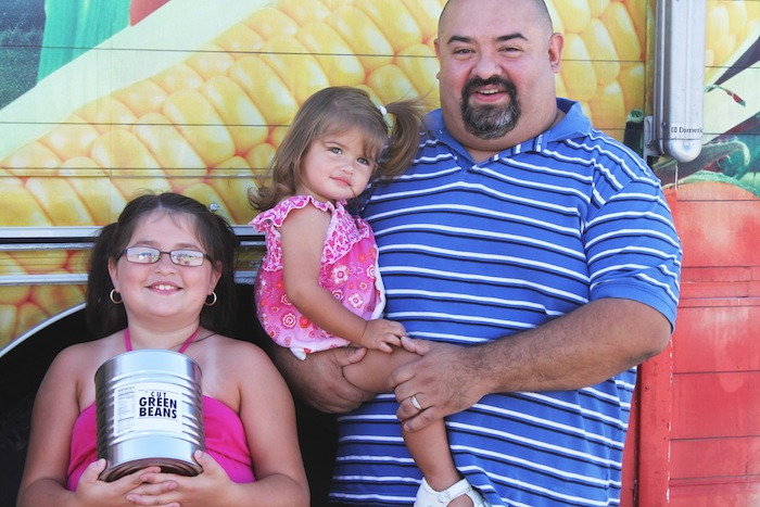 Mike and his family at a mobile food distribution hosted by the San Antonio Food Bank. Courtesy photo.