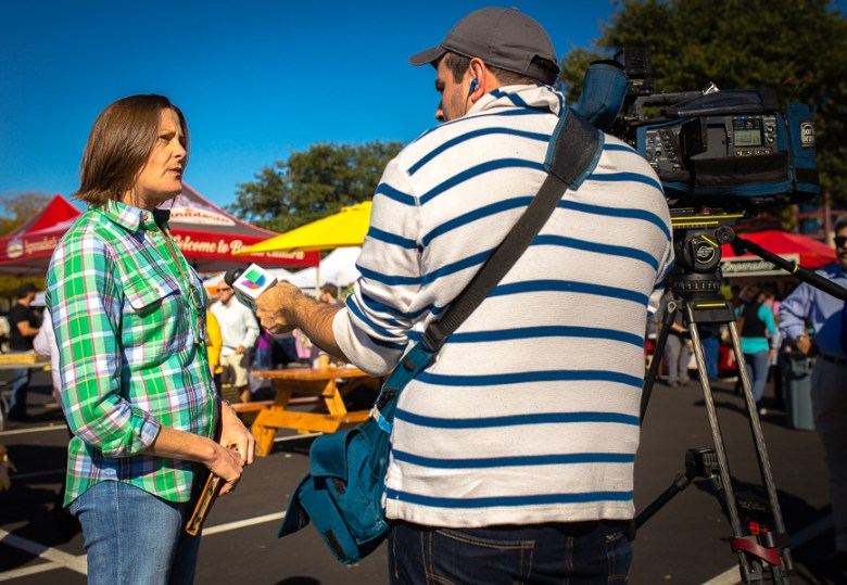 Market Founder Heather Hunter is interviewed at the Quarry Farmers & Ranchers Market. Photo by Scott Ball.