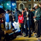 Pastor David Runnels and protestors take a moment of silence at the SATX4Ferguson protest. Photo by Scott Ball.