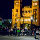 Protestors line up in front of the Bexar County Courthouse during the SATX4Ferguson protest. Photo by Scott Ball.