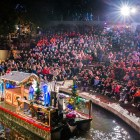 A float passes through the Arneson River Theater during the Holiday River Parade. Photo by Scott Ball.