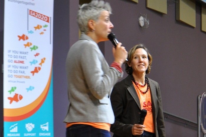 Jeanne Russell (right) looks on as Molly Cox addresses the crowd gathered for the SA2020 Progress Report in 2014. Photo by Iris Dimmick.
