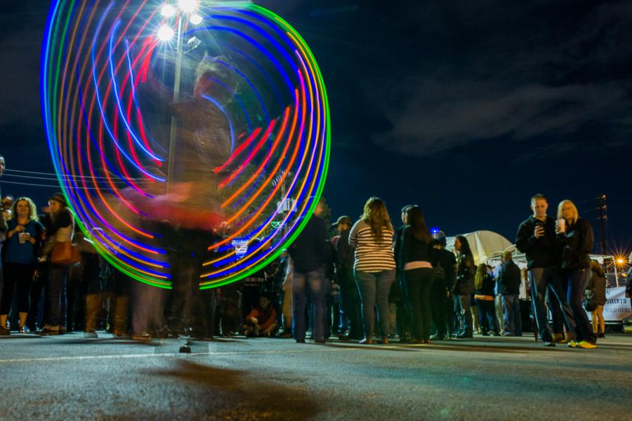A woman spins an illuminated ring during Luminaria 2014. Photo by Scott Ball.