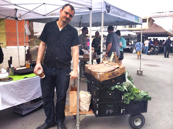 Michael Sohocki stocking up for a week of dinner service at the Pearl Farmers Market. Photo courtesy of Facebook. /www.facebook.com/RestaurantGwendolyn