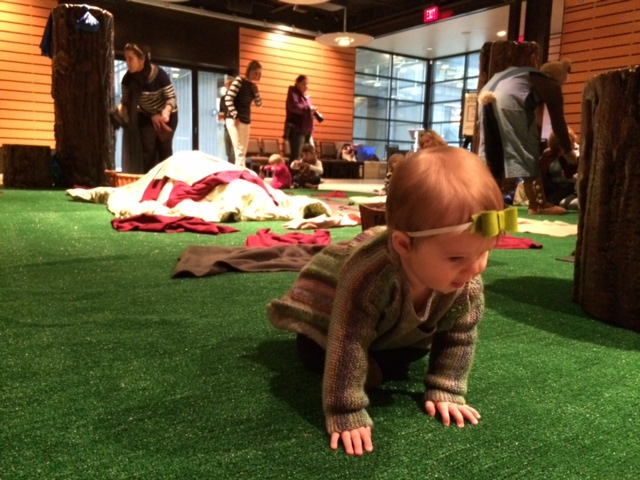 """Urban Baby Moira McNeel watches The Magik Theatre's production of """"Wake Up Brother Bear."""" Photo by Bekah McNeel."""