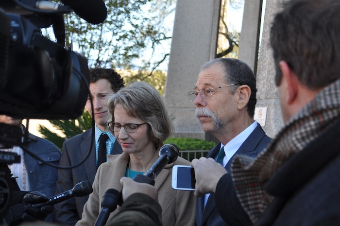 Mickey Redus talks to media outside the U.S. Federal Courthouse as his wife, Valerie, and eldest son, Kristopher, look on. Photo by Iris Dimmick.