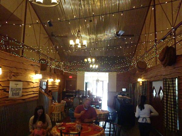 Families enjoy local food at the beautifully lit Sandy Oaks Restaurant in Elmendorf, TX.