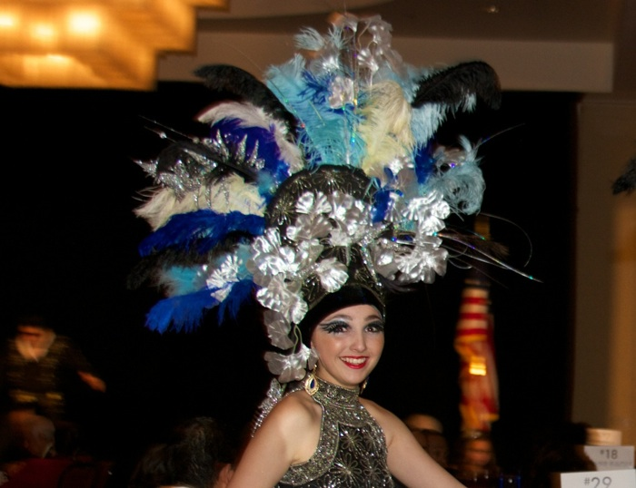 Dancers wound through the crowd wearing colorful feathered headdresses during the show, choreographed by Rebecca Medina. Courtesy photo