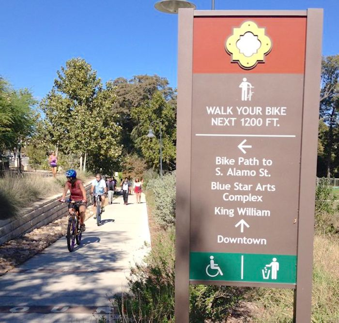Cyclists disobey signage to walk their bikes on a stretch of the Eagleland Reach. Photo by Robert Rivard.