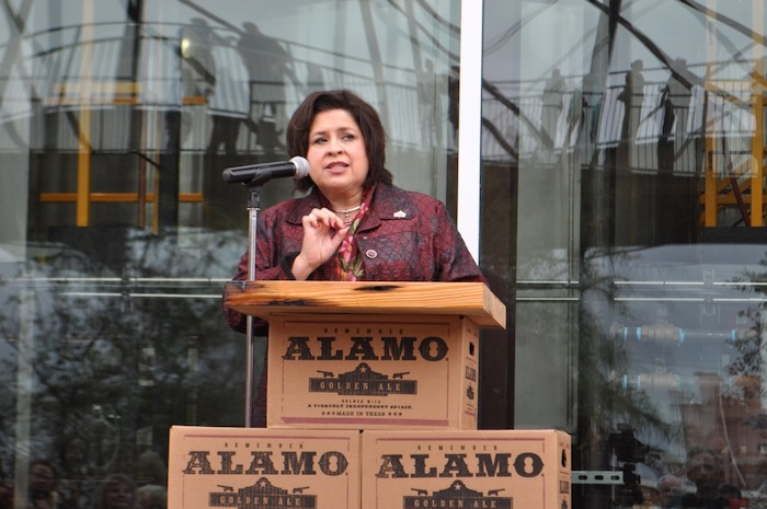 Leticia Van de Putte speaks to the large crowd gathered at the brewery's ribbon cutting ceremony. Photo by Iris Dimmick.
