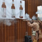 Historic reenactors fire unloaded rifles during the Alamo Beer Company brewery ribbon-cutting. Photo by Iris Dimmick.