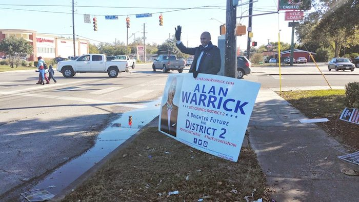 Alan Warrick campaigns in District 2 during early voting. Photo courtesy of Facebook.