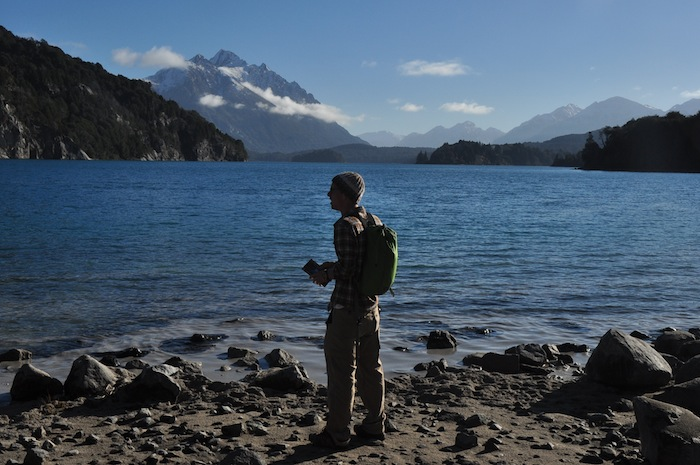 """Cameron Redus looks out over a lake near Cerro Catedral. This was Cam's favorite picture that his brother, Everett, took of him. """"When I write a travel book, I want this on the cover,"""" Cam said. Photo by Everett Redus."""