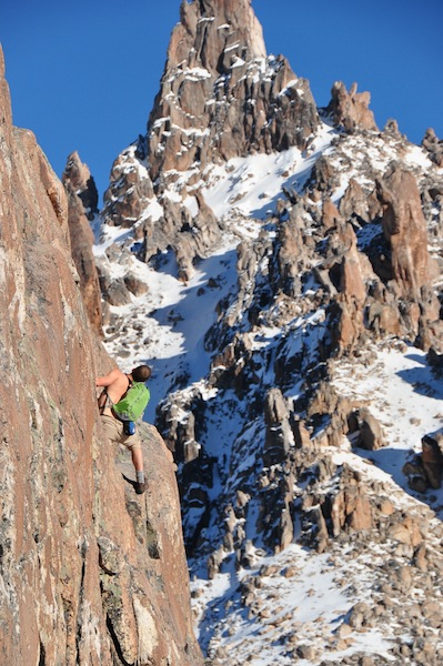 Cameron Redus contemplates his next move on a cliff face of Cerro Catedral mountain, Argentina. Photo by Everett Redus.