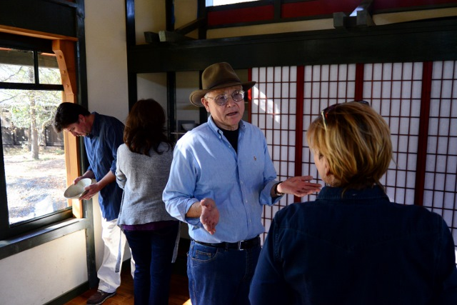 Dudley Harris (center) discusses his work and process. Photo by Page Graham.