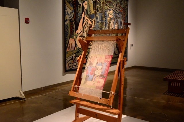 A traditional hand loom in place for demonstrations on loan from the Southwest School of Art. Photo by Page Graham.