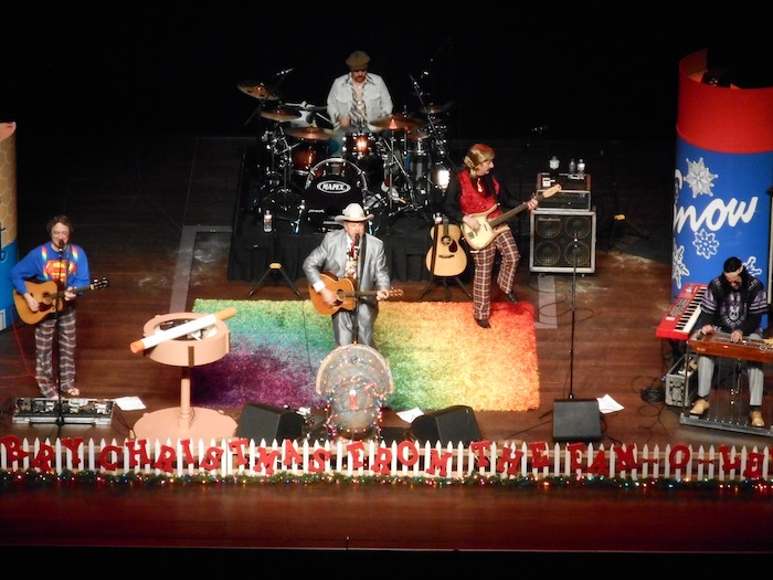 Plaid pants, bell-bottoms, and hippie headbands provide a flashback to a 70s Christmas with Robert Earl Keen. Photo by Don Mathis.