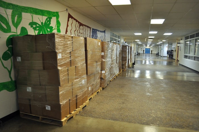 """More than 1,000 boxes of food from the Redeemer Presbyterian Church to be distributed to """"adopted"""" families at the Family Service Association. Photo by Iris Dimmick."""