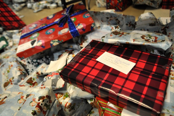 A kitten puzzle is wrapped and ready for a little girl in need at the Family Service Association. Photo by Iris Dimmick.