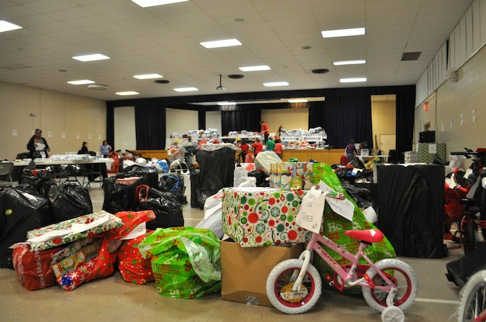 Presents pile up for families in need at the Family Service Association. Photo by Iris Dimmick.