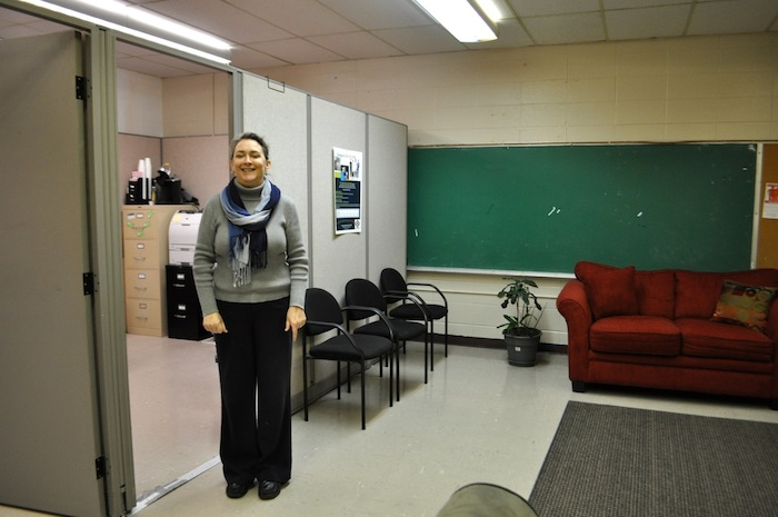 Financial Empowerment Center Director Kim Arispe poses for a photo at Family Service Assocation. Photo by Iris Dimmick.
