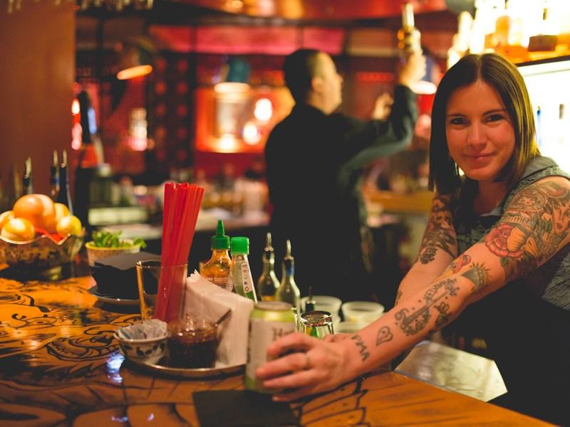 Hoy Joy bartender Danielle Chapman serves a beer. Photo by Scott Ball.