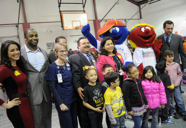 From left: KABB-TV's Erin Nichols, Former NFL Player Tyreo Harrison, Michelle Ryerson of UHS, Harlandale Superintendent Rey Madrigal and Councilmember Rebecca Viagran join students for a photo opportunity at Rayburn Elementary School. Photo by Kristian Jaime.
