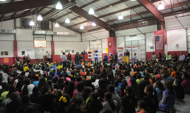 Kids file in for the Go!Kids Challenge pep rally at Rayburn Elementary School. Photo by Kristian Jaime.