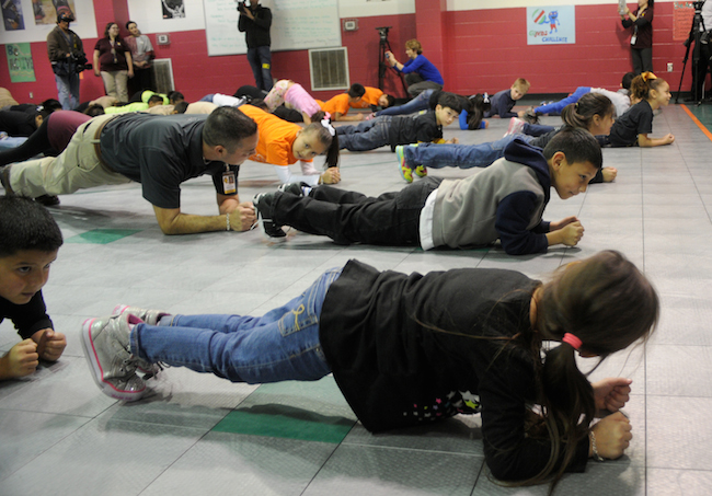 Kids learn about basic exercises they can do at home for the Go!Kids Challenge event held at Rayburn Elementary School. Photo by Kristian Jaime.