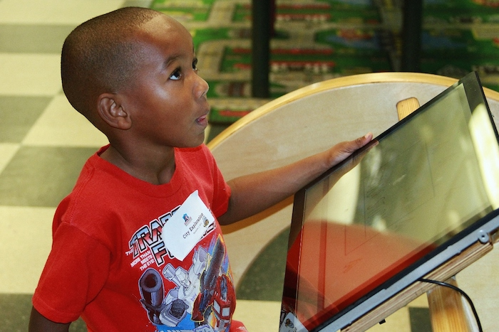 A young student engages interactive technology at the DoSeum as a part of San Antonio is Our Classroom. Photo courtesy of P16.