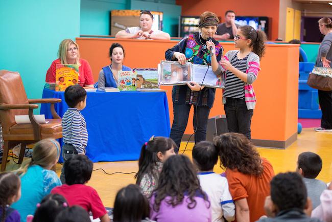 San Antonio's inaugural Poet Laureate Carmen Tafolla reads to children at the San Antonio Children's Museum during DreamWeek. Photo by Sarah Brooke Lyons.