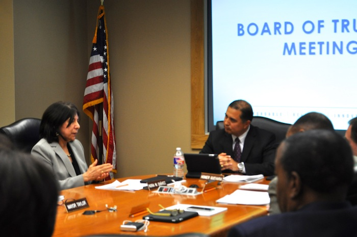 CPS Energy Board of Trustees Chair Homer Guevara (right) listens to praise from Vice Chair Nora Chávez after the board unanimously approved her election to take over as chair. Photo by Iris Dimmick.