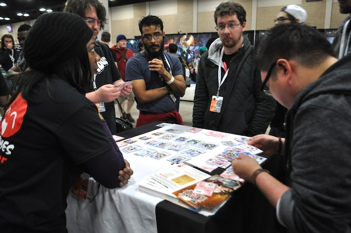 Attendees try out a new tabletop game during PAX South. Photo by Iris Dimmick.