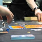 Attendees play a new tabletop game during PAX South. Photo by Iris Dimmick.