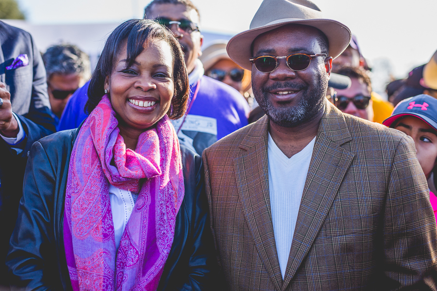 Mayor Ivy Taylor and her husband, Rodney, pose for a photo at the 2015 MLK March. Photo by Scott Ball.