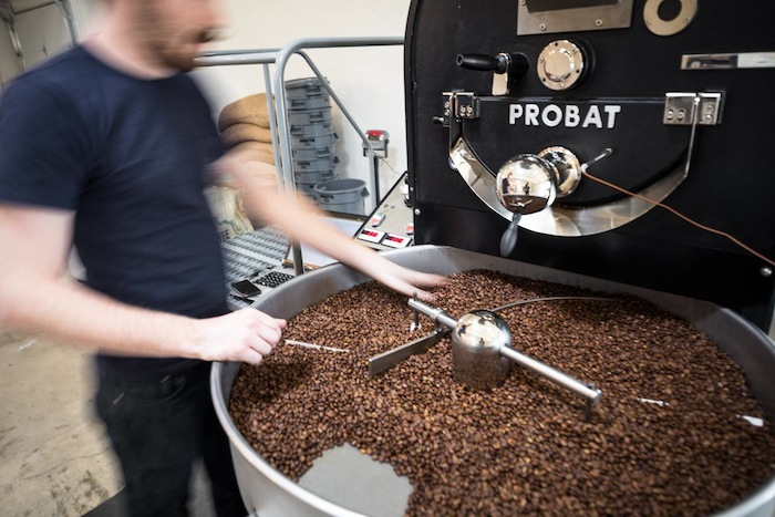 Merit Roasting Co. roasts and delivers coffee daily. Photo by Scott Martin.