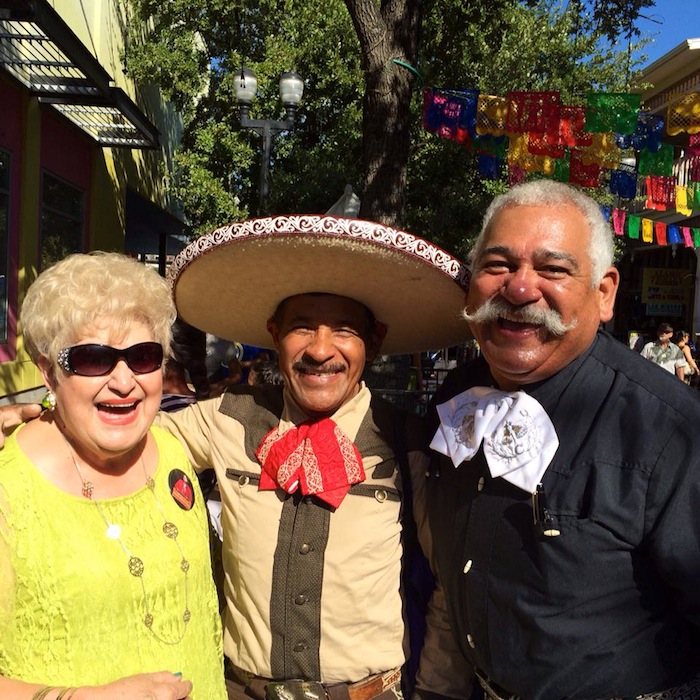 (From left) Belle San Miguel Ortiz and Juan Ortiz took time to visit a special friend, Victoriano Flores at Market Square. Photo by Anthony Medrano.