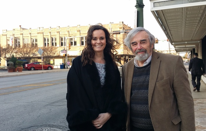 Office of Historic Preservation Director Shanon Miller and PlaceEconomics principal Donovan Rypkema pose for a photo in downtown San Antonio. A vacant historic building in the background. Photo by Iris Dimmick.