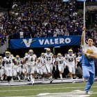 UCLA takes the field during the 2015 Valero Alamo Bowl held on Jan. 2, 2015, at the Alamodome. Photo by Kristian Jaime.