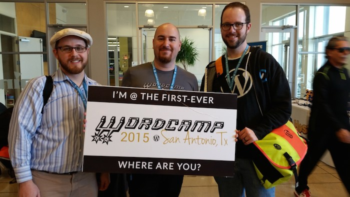 WordPress developer and Lead Instructor for WebTegrity Wayne McWilliams (center) poses for a photo at WordCamp San Antonio. Courtesy photo.