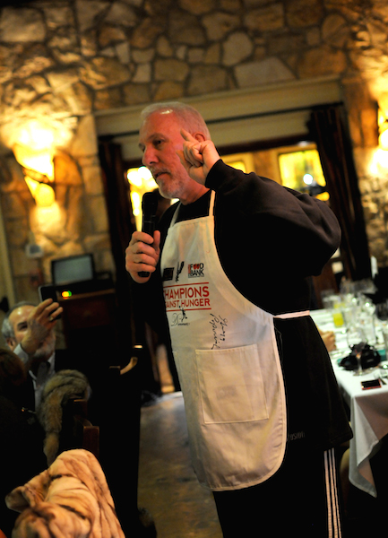 San Antonio Spurs Head Coach Gregg Popovich welcomes guests to the Fourth Annual Champions Against Hunger Fundraising Dinner held at the The Grill in Leon Springs. Photo by Kristian Jaime.