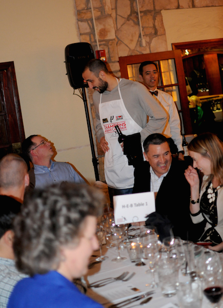 San Antonio Spur Manu Ginobili offers wine options to guests during the Fourth Annual Champions Against Hunger Fundraising Dinner held at the The Grill in Leon Springs. Photo by Kristian Jaime.