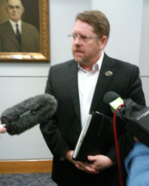 Mike Helle, San Antonio Police Officers Association president, addresses media following a meeting between negotiators from the city and the union on Friday. Photo by Edmond Ortiz.