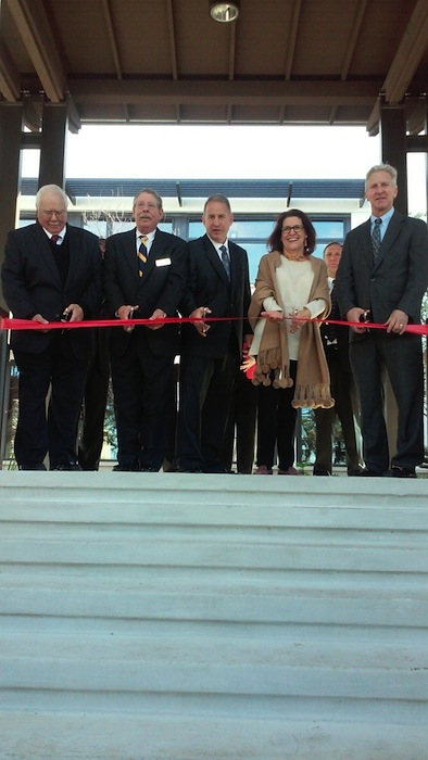 Alamo Heights City Council members cut the ribbon on the new municipal complex Thursday. From left: Fred Prassel, Bobby Hasslocher, Mayor Louis Cooper, Lynda Billa Burke and Bobby Rosenthal. Councilman John Savage was out of town on business. Photo by Edmond Ortiz.