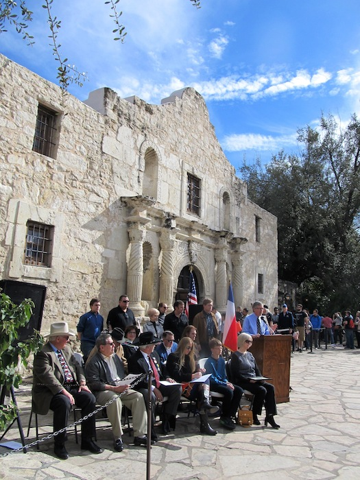 Dedication ceremony at the Alamo. Dr. Gregg J. Dimmick, historian, gives the history of the cannon. Photo by Carol Baass Sowa for Today's Catholic.