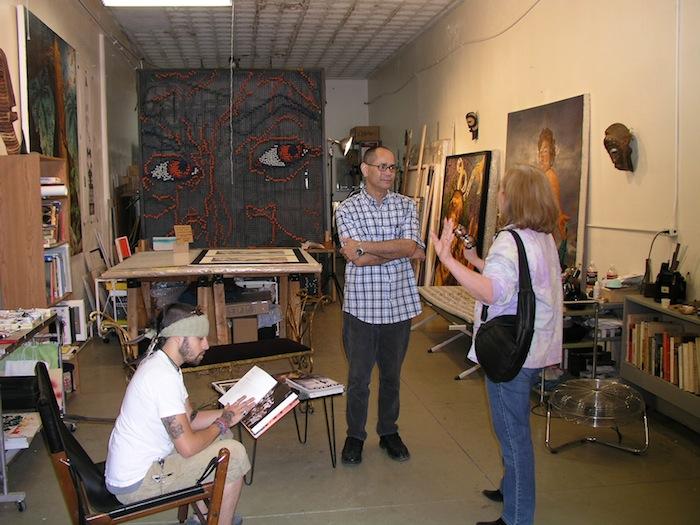 Angel Rodriguez-Diaz and curator Kellen McIntyre chat in Angel's studio. Photo by Eric lane