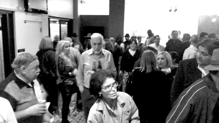 """A crowd fills up the Guadalupe Theater lobby ahead of a world premiere screening of documentary, """"Children of Giant,"""" as part of CineFestival on Saturday at the Guadalupe Theater. Photo by Edmond Ortiz."""