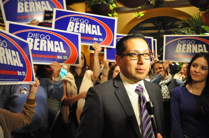 Rep. Diego Bernal answers questions from the media while his fiance, Elyse Alaniz, looks on during his election watch party. Photo by Iris Dimmick.