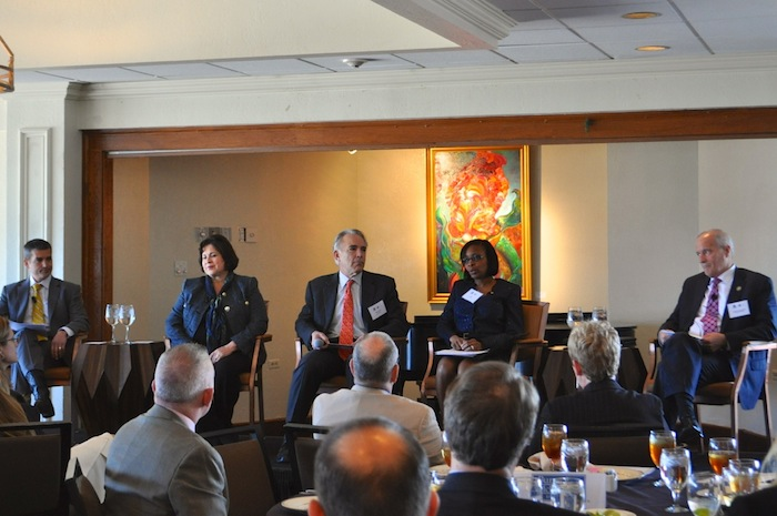 (From left) Former state Rep. Mike Villarreal, State Sen. Leticia Van de Putte, moderator Robert Rivard, Mayor Ivy Taylor, and former County Commissioner Tommy Adkisson attend the mayoral candidate forum at the Plaza Club on Wednesday. Photo by Iris Dimmick.