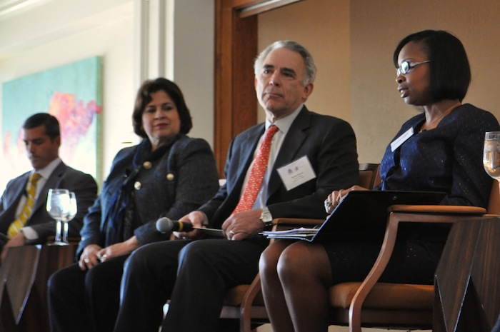 Mayor Ivy Taylor (right) speaks during the mayoral candidate forum at the Plaza Club on Wednesday while (from left) Mike Villarreal, Leticia Van de Putte and Moderator Robert Rivard look on. Photo by Iris Dimmick.